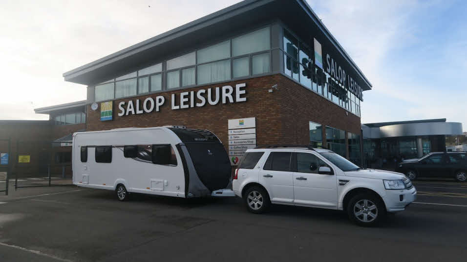 4x4 towing caravan outside Salop Leisure depot