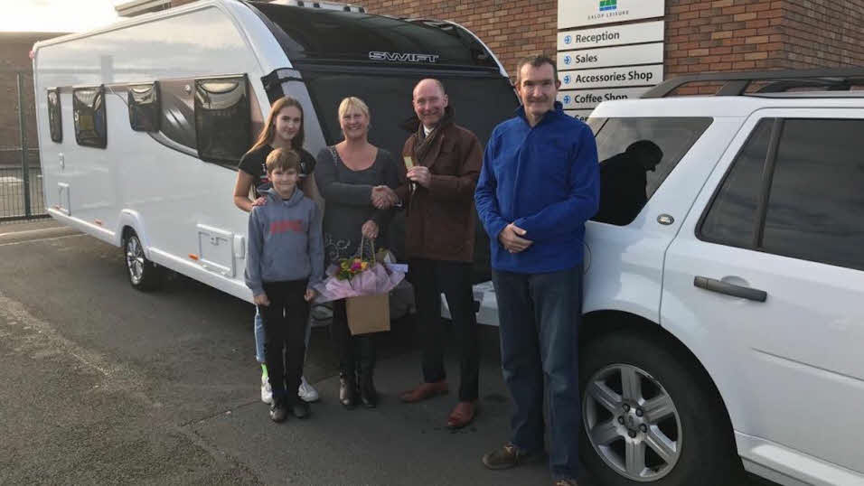a family picking up their new caravan