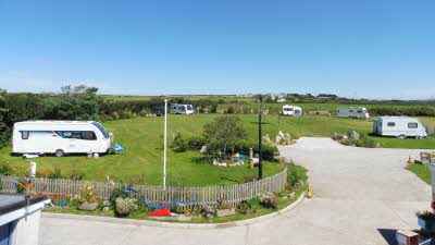 Dunree Certificated Location, PL33 9DY, Cornwall, Camelford, CL owner, 2020, pitch, grass, site, field, trees, fence, awning