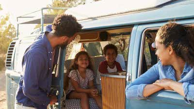 Family in their campervan