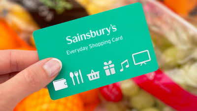 Sainsbury's Everyday Shopping Card with groceries in the background