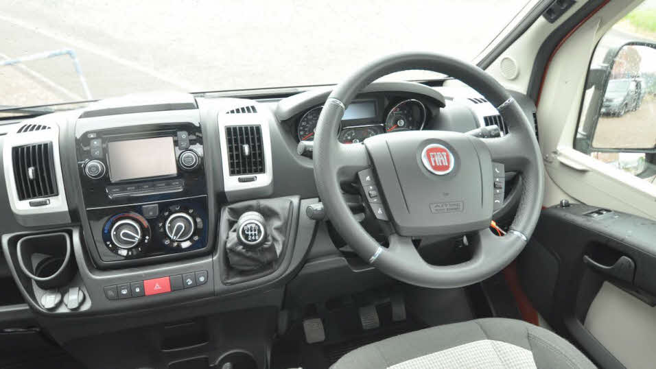 Fiat steering wheel and dashboard, with air con controls