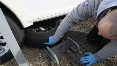 man checking condition of spare tyre