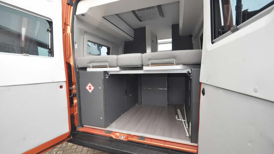 Under bed storage accessed through back of van