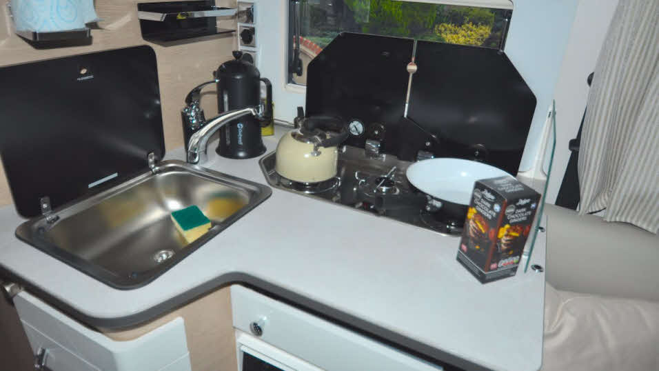 Motorhome kitchen with three ring hob and sink