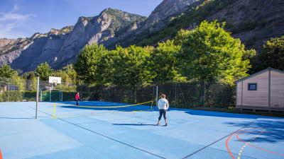 A La Rencontre du Soleil, M19, Rhone-Alpes, France, Overseas, 2021, basketball court, people, tres, mountain