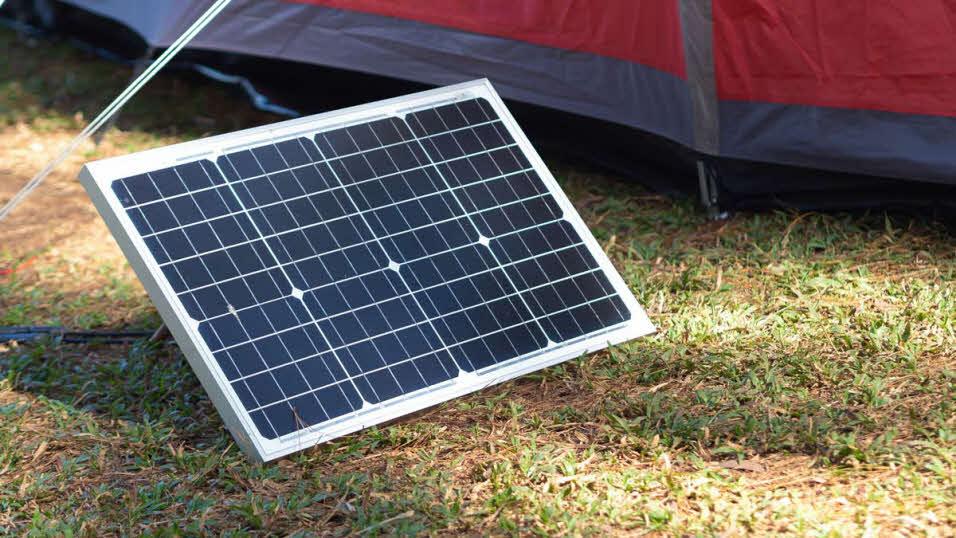 Portable solar panel on a campsite