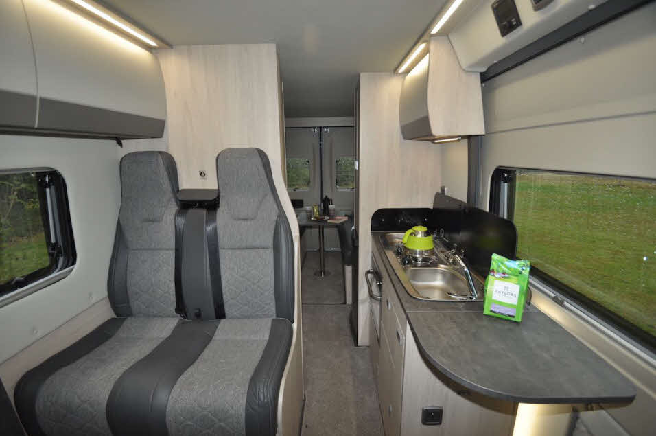 Back to front view of Auto-Trail Adventure 65 LB campervan with seating, kitchen