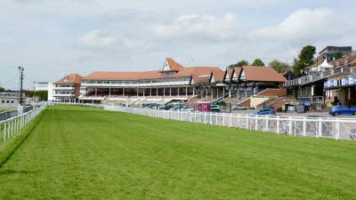 The racetrack and main stand at Chester Racecourse in Chester