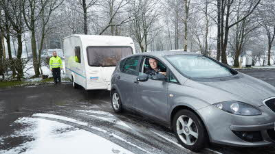 winter caravanning with car towing a caravan on snow