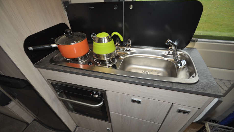 camper-style two ring hob and sink, with fitted grill/warming oven