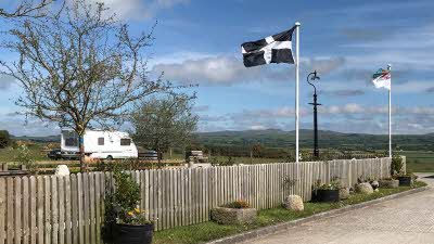 Dunree Certificated Location, PL33 9DY, Cornwall, Camelford, CL owner, 2020, pitch, caravan, flag, fence