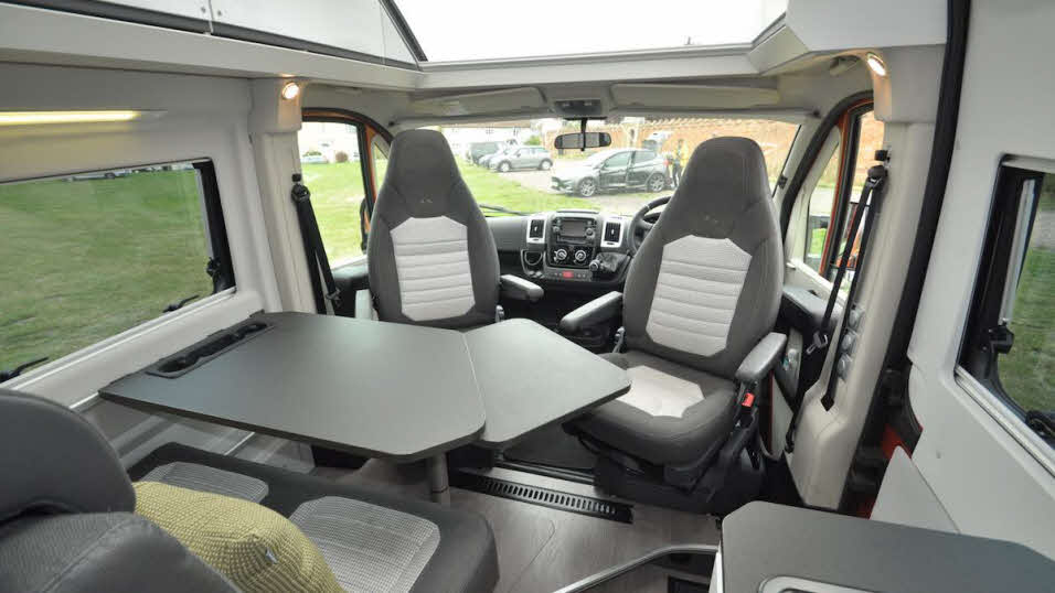 Revolving driving seats and table