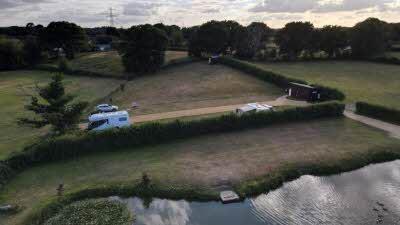 Clump Hill Farm, BH21 7JT, Wimborne Minster, Dorset, CL owner, 2020, aerial view, pitch, grass, caravan, car, trees, grass, pond