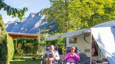 A La Rencontre du Soleil, M19, Rhone-Alpes, France, Overseas, 2021, caravan, couple, mountain, trees, awning
