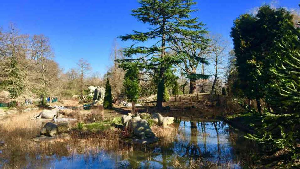 Fake dinosaurs at watering hole at Crystal Palace Park
