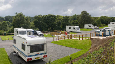 Motorhomes and caravans parked up at the campsite